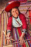 Peruvian woman weaving in Chinchero