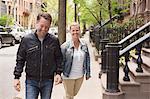 Smiling couple walking on street