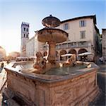 Fountain with Santa Maria sopra Minerva Church, Piazza del Comune Square, Assisi, Perugia District, Umbria, Italy, Europe