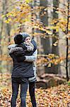 Girls hugging in autumn forest