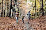Girls running in autumn forest