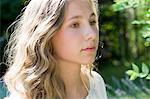 Portrait of serene teenage girl in garden