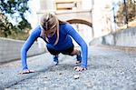 Woman doing push ups on bridge, Arroyo Seco Park, Pasadena, California, USA