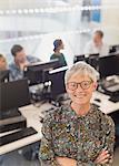 Portrait confident senior woman in adult education computer classroom