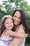 Portrait smiling mother holding daughter