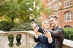 Young couple taking selfie outside Albert Hall, London, England, UK