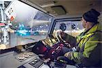 Tug driver moving A380 aircraft on runway at night
