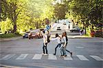 Side view of teenagers crossing road