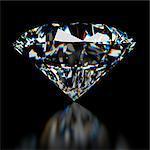 Diamond against a black background, computer illustration.