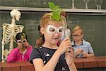 School children with teacher doing experiment in biology class, Fürstenfeldbruck, Bavaria, Germany