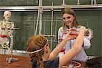 School girl with teacher doing experiments in chemistry class, Fürstenfeldbruck, Bavaria, Germany