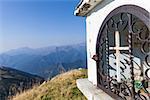 Christian chapel during a sunny day on Italian Alps - faith concept