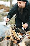 Man making campfire