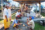 Men preparing food at outdoor kitchen, Penglipuran, traditional Balinese village, Bangli, Bali, Indonesia