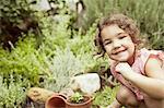Portrait of little girl gardening