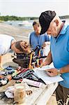 Men repairing boat