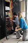 Technicians looking at open server locker