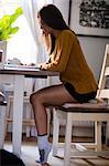 Young woman holding mug and studying