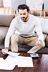 Focused man paying bills