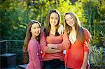 backyard portrait, three teen sisters