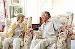 Happy senior friends in nursing home