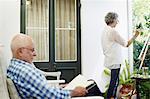 Senior couple spending leisure time at porch