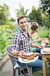 Man With Fresh Grilled Bratwurst
