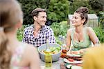 Man And Woman Flirting In Garden