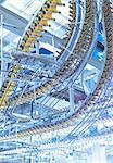 Winding printing press conveyor belts overhead