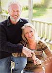 Portrait smiling senior couple on porch