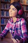 Thoughtful female student listening music