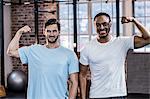 Two muscular men flexing biceps