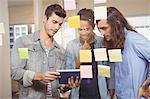Businessmen discussing over digital tablet