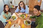 Portrait of happy business people having breakfast