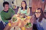 Portrait of happy creative business people having breakfast