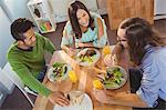 Business people talking while having breakfast