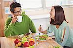 Business people having breakfast in creative office