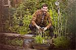 Smiling man holding vegetables