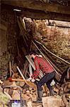 Man chopping wood outside