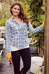 Smiling woman posing in her garden