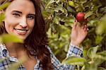 Portrait of woman touching apple