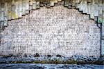 White brick wall and a side walk