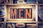 """The word """"Men"""" written in vintage wooden letterpress type."""