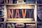 """The word """"Navy"""" written in vintage wooden letterpress type."""