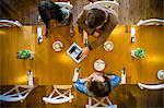 Friends using digital tablet in restaurant