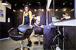 Female hairstylist in hair salon