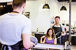 Customer with hairstylist in hair salon