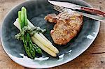 Pork chop with asparagus and coriander pesto