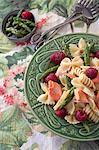 Pasta salad with salmon, asparagus, raspberries and a lemon vinaigrette