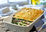 Spinach lasagne with ham and mozzarella